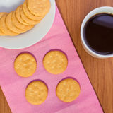 Crackers or biscuits on wooden Royalty Free Stock Photos