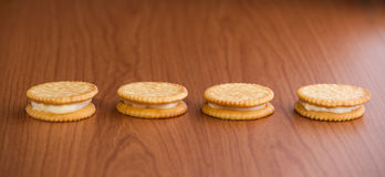 Crackers or biscuits on wooden Royalty Free Stock Photo