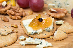 Crackers with blue cheese and apple jam, nuts and grapes Royalty Free Stock Image