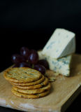 Crackers Blue cheese and Grapes Stock Photos