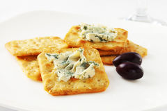 Crackers with Blue Cheese and Olives Stock Photos