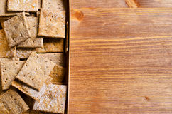 Crackers with bran. Cracker square shape with bran. Selective focus Stock Image