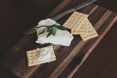 Crackers on Brown Chopping Board Royalty Free Stock Image