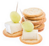 Crackers with Camembert on white Royalty Free Stock Photos