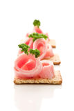 Crackers canapes with ham and parsley Royalty Free Stock Photography
