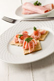 Crackers canapes with ham and parsley Royalty Free Stock Photo
