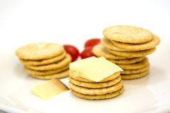 Crackers and cheese. Snack on a plate with tomatoes Royalty Free Stock Photo