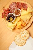 Crackers and Cheese. Crackers, Olives, cheese and grapes on a wooden restaurant table stock photos