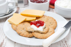 Crackers with cheese, cream and jam for breakfast, close-up Royalty Free Stock Image