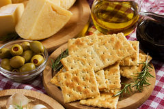 Crackers with cheese and olives Royalty Free Stock Photo
