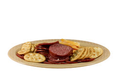 Crackers, cheese and sausage platter isolated Stock Photo
