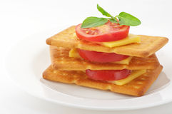 Crackers with cheese, tomato and basil Stock Photo