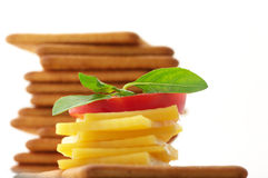 Crackers with cheese, tomato and basil Royalty Free Stock Photo