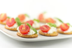Crackers with Cheese Tomato and Basil Stock Images