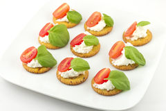 Crackers with Cheese Tomato and Basil Stock Photos
