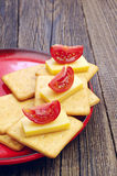 Crackers with cheese and tomato Stock Image
