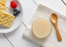 Crackers with condensed milk and fruit. Breakfast stock photography
