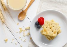 Crackers with condensed milk and fruit. Breakfast stock image