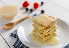 Crackers with condensed milk and fruit. Breakfast royalty free stock photography