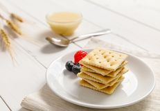 Crackers with condensed milk and fruit, breakfast Royalty Free Stock Photography