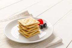 Crackers with condensed milk and fruit Royalty Free Stock Photography