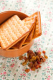 Crackers cookies and raisin on table Stock Photos