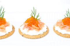 Crackers with cream cheese, salted salmon and red caviar Royalty Free Stock Image