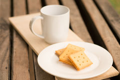 Crackers with cup of milk. On wood table Royalty Free Stock Image