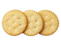 Crackers die op witte achtergrond worden geïsoleerd= Stock Foto