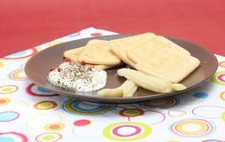 Crackers with a dip Stock Images