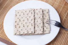 Crackers in a dish and fork Stock Photography