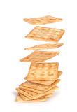 The crackers fall on the stack of square crackers Royalty Free Stock Photography