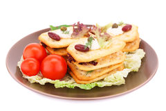 Crackers with fresh vegetables and cream. On brown plate Royalty Free Stock Image