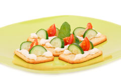 Crackers with fresh vegetables and cream Stock Photos