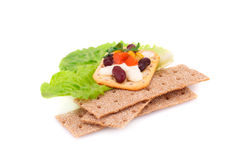 Crackers with fresh vegetables and cream. Crackers stacks with fresh vegetables and cream isolated on white background Stock Images