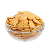Crackers in glass bowl isolated over white Stock Image