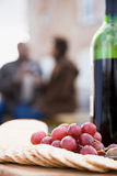 Crackers Grapes And A Bottle Of Wine Royalty Free Stock Photography