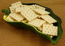 Crackers green leaf dish Royalty Free Stock Image