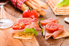 Crackers with ham and avocado. Stock Photo