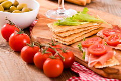 Crackers with ham and avocado. Royalty Free Stock Images