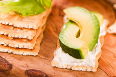 Crackers with ham and avocado. Stock Image