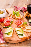 Crackers with ham and avocado. Royalty Free Stock Photos