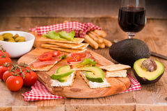 Crackers with ham and avocado. Royalty Free Stock Photography