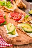 Crackers with ham and avocado. Royalty Free Stock Image