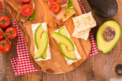 Crackers with ham and avocado. Royalty Free Stock Photo