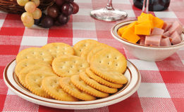 Crackers with ham and cheese Stock Images