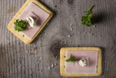 Crackers with ham and roumulade sauce Stock Photography