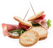 Crackers with Ham on white Stock Image
