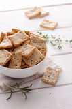 Crackers with herbs and black sesame seeds on table Stock Photo
