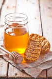 Crackers and honey Royalty Free Stock Images